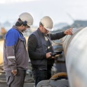 Two men from Buffalo Inspections conducting welding inspections